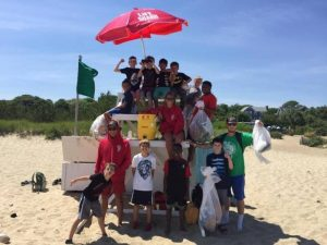 Club Members at the beach on a llife guard stand