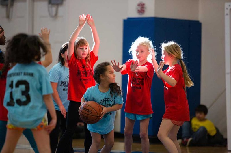 A group of girls playing basketball