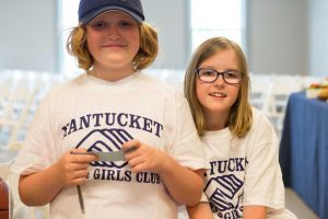 Two children wearing Nantucket Boys and Girls club shirts