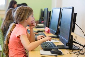 young girl in the computer lab
